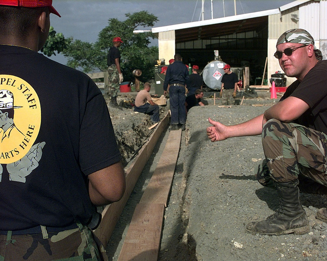 US Air Force STAFF Sergeant Andrew Branson from the 820th Red Horse Squadron, Nellis Air Force Base, Nevada, talks with US Air Force Captain Shon Neyland about the building procedure of the foundation footing form of the new Marine barracks being built in Castries, Saint Lucia. Approximately 100 Marine, Army and Air Force personnel have deployed to Saint Lucia as part of Exercise NEW HORIZONS. New Horizons has a two fold mission of readiness training and humanitarian assistance in the Caribbean and Latin America