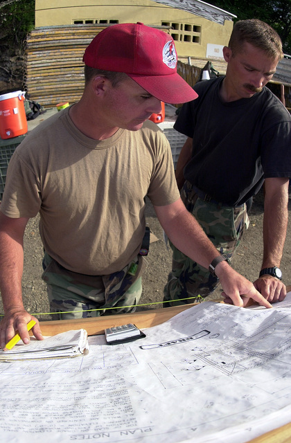 US Air Force STAFF Sergeant John Folias and US Air Force STAFF Sergeant Daniel Wolfrum of the 820th Red Horse Squadron, Nellis Air Force Base, Nevada, go over blueprints for new Marine barracks being built in Castries, Saint Lucia, in support of Operation NEW HORIZONS. Approximately 100 Marine, Army and Air Force personnel have deployed to Saint Lucia as part of New Horizons. The operation has a two fold mission of readiness training and humanitarian assistance in the Caribbean and Latin America