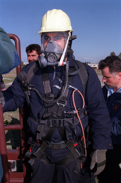 Ferit Ipekbayrak, Incirlik Air Base Fire Department Crew CHIEF, receives his final check prior to taking part in a Confined Space Rescue Operations training exercise, outside of a Petroleum Oil Lubricants storage facility at Incirlik Air Base, Turkey