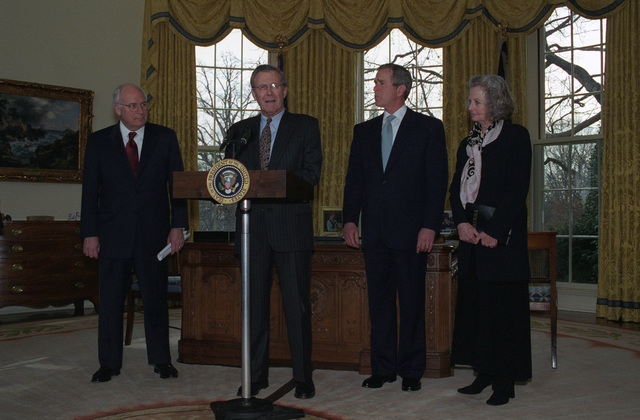 The Honorable Donald H. Rumsfeld (at podium), U.S. Secretary of Defense, says a few words during his Oath of Office Ceremony at the Oval Office of the White House, Washington, D.C., Jan. 26, 2001.  The Honorable George W. Bush (center, right), President of the United States, the Honorable Richard B. Cheney (left), Vice President of the United States, and Mrs. Joyce Rumsfeld (right), are also present.  OSD Package No. 010126-D-9880W-001-012 (PHOTO by Robert D. Ward) (Released)