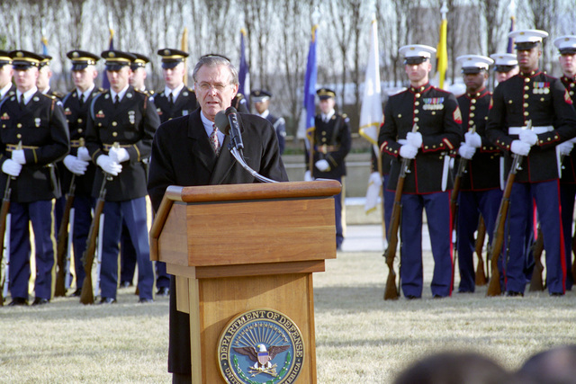 The Honorable Donald H. Rumsfeld (at the podium), U.S. Secretary of Defense (SECDEF), says a few words at the Armed Forces Welcoming Ceremony held on the River Entrance Parade Field, the Pentagon, Washington, D.C., Jan. 26, 2001, following his Oath of Office Ceremony at the White House.  OSD Package No. 010126-D-9880W-0013 to 0030 (PHOTO by Robert D. Ward) (Released)