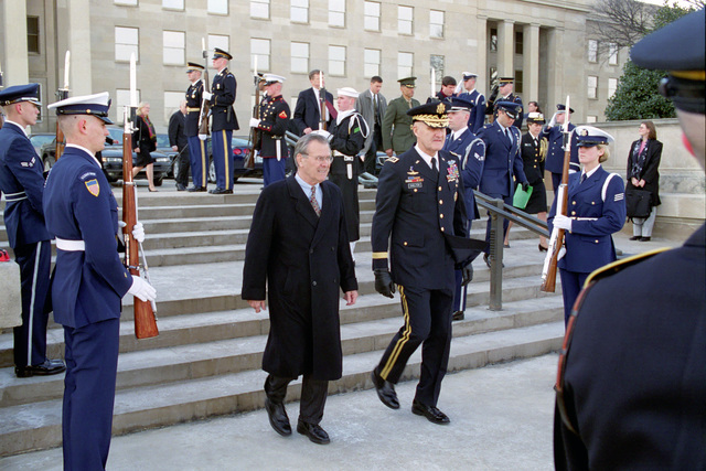 The Honorable Donald H. Rumsfeld (center, left), U.S. Secretary of Defense (SECDEF), departs the Pentagon, Washington, D.C., Jan. 26, 2001, with U.S. Army GEN. Henry H. Shelton, Chairman of the Joint Chiefs of STAFF.  OSD Package No. 010126-D-9880W-0013 to 0030 (PHOTO by Robert D. Ward) (Released)