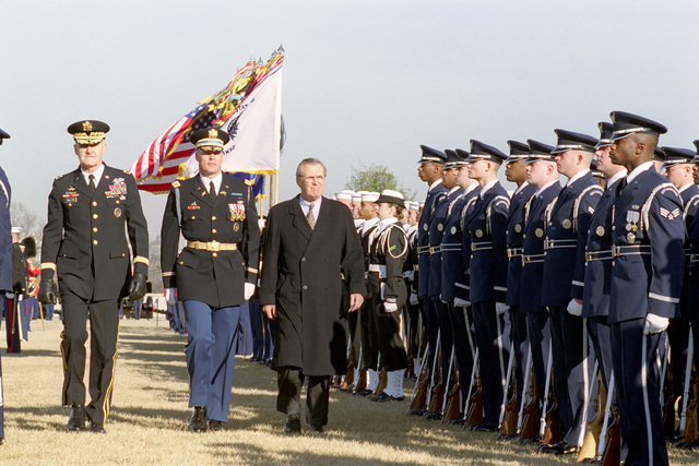 The Honorable Donald H. Rumsfeld (center, right), U.S. Secretary of Defense (SECDEF), U.S. Army GEN. Henry H. Shelton (left), Chairman of the Joint Chiefs of STAFF, and U.S. Army COL. Thomas Jordan, Commander of Troops, inspect the Joint Services Honor Guard at the Armed Forces Welcoming Ceremony held on the River Entrance Parade Field, the Pentagon, Washington, D.C., Jan. 26, 2001, following his Oath of Office Ceremony at the White House.  OSD Package No. 010126-D-9880W-0013 to 0030 (PHOTO by Robert D. Ward) (Released)