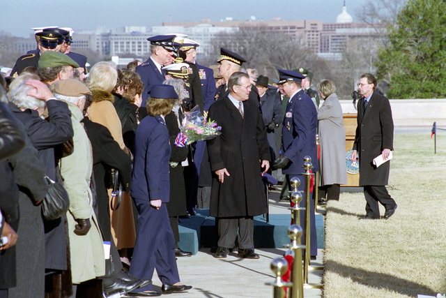 The Honorable Donald H. Rumsfeld (center), U.S. Secretary of Defense (SECDEF), and his wife, are greeted by Officers of the Armed Forces at the Armed Forces Welcoming Ceremony held on the River Entrance Parade Field, the Pentagon, Washington, D.C., Jan. 26, 2001, following his Oath of Office Ceremony at the White House.  OSD Package No. 010126-D-9880W-0013 to 0030 (PHOTO by Robert D. Ward) (Released)