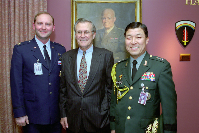 The Honorable Donald H. Rumsfeld (center), U.S. Secretary of Defense (SECDEF), poses for a picture with Republic of Korea Army MAJ. GEN. Young Han Moon (right), Defense Attache'to the Republic of Korea, in the Pentagon, Room 2E880, Washington, D.C., Jan. 26, 2001, following his Oath of Office Ceremony at the White House.  OSD Package No. 010126-D-9880W-0013 to 0030 (PHOTO by Robert D. Ward) (Released)