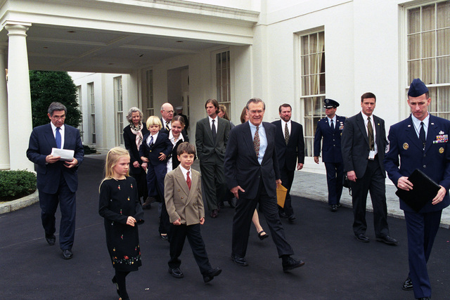 The Honorable Donald H. Rumsfeld (center), U.S. Secretary of Defense, the Honorable Paul D. Wolfowitz (left), Deputy Secretary of Defense, and the Rumsfeld family attendees depart after the Oath of Office Ceremony at the White House, Washington D.C., Jan. 26, 2001.  OSD Package No. 010126-D-9880W-001-012 (PHOTO by Robert D. Ward) (Released)
