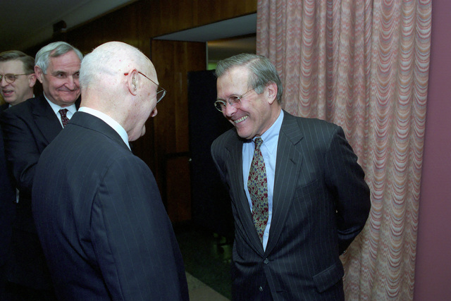 The Honorable Donald H. Rumsfeld (right), U.S. Secretary of Defense (SECDEF), is greeted by Andrew W. Marshall, Director, Department of Defense Office of Net Assessment, in the Pentagon, Room 2E880, Washington, D.C., Jan. 26, 2001, following his Oath of Office Ceremony at the White House.  OSD Package No. 010126-D-9880W-0013 to 0030 (PHOTO by Robert D. Ward) (Released)