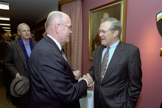 The Honorable Donald H. Rumsfeld (right), U.S. Secretary of Defense (SECDEF), is greeted by the Honorable Melvin R. Laird, Former U.S. Secretary of Defense (1969-1973), in the Pentagon, Room 2E880, Washington, D.C., Jan. 26, 2001, following his Oath of Office Ceremony at the White House.  OSD Package No. 010126-D-9880W-0013 to 0030 (PHOTO by Robert D. Ward) (Released)