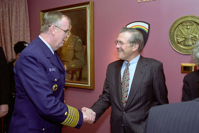 The Honorable Donald H. Rumsfeld (right), U.S. Secretary of Defense (SECDEF), is greeted by U.S. Navy Admiral James M. Loy, Commandant of the U.S. Coast Guard, in the Pentagon, Room 2E880, Washington, D.C., Jan. 26, 2001, following his Oath of Office Ceremony at the White House.  OSD Package No. 010126-D-9880W-0013 to 0030 (PHOTO by Robert D. Ward) (Released)