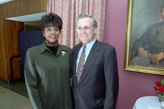 The Honorable Donald H. Rumsfeld (right), U.S. Secretary of Defense (SECDEF), poses for a picture with Mamie Burke, photographer to the Chairman of the Joint Chiefs of STAFF, in the Pentagon, Room 2E880, Washington, D.C., Jan. 26, 2001, following his Oath of Office Ceremony at the White House.  OSD Package No. 010126-D-9880W-0013 to 0030 (PHOTO by Robert D. Ward) (Released)