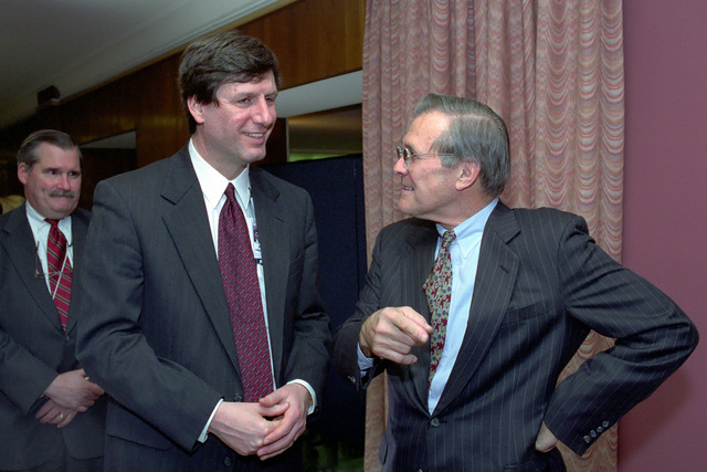 The Honorable Donald H. Rumsfeld (right), U.S. Secretary of Defense (SECDEF), speaks with Dr. Stephen Cambone, a key member of his transition team, in the Pentagon, Room 2E880, Washington, D.C., Jan. 26, 2001, following his Oath of Office Ceremony at the White House.  OSD Package No. 010126-D-9880W-0013 to 0030 (PHOTO by Robert D. Ward) (Released)