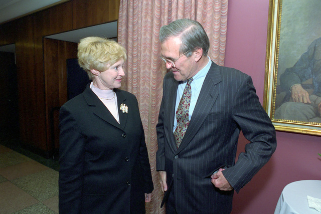 The Honorable Donald H. Rumsfeld (right), U.S. Secretary of Defense (SECDEF), speaks with Mary Deutsch, of the Protocol Office, in the Pentagon, Room 2E880, Washington, D.C., Jan. 26, 2001, following his Oath of Office Ceremony at the White House.  OSD Package No. 010126-D-9880W-0013 to 0030 (PHOTO by Robert D. Ward) (Released)