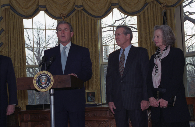 The Honorable George W. Bush (center, left), President of the United States, Mrs. Joyce Rumsfeld (at podium), says a few words at the Oath of Office Ceremony for the Honorable Donald H. Rumsfeld (center, right), U.S. Secretary of Defense, at the Oval Office of the White House, Washington, D.C., Jan. 26, 2001.  Mrs. Joyce Rumsfeld (right), stands next to her husband.  OSD Package No. 010126-D-9880W-001-012 (PHOTO by Robert D. Ward) (Released)