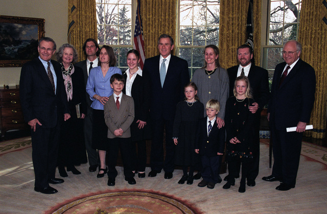 The Honorable George W. Bush (center), President of the United States, and the Honorable Richard B. Cheney (right), Vice President of the United States, pose for a photo with the Honorable Donald H. Rumsfeld (left), U.S. Secretary of Defense, and his family after the Oath of Office Ceremony at the Oval Office of the White House, Washington, D.C., Jan. 26, 2001.  OSD Package No. 010126-D-9880W-001-012 (PHOTO by Robert D. Ward) (Released)