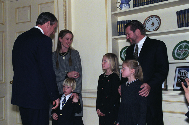 The Honorable George W. Bush (left), President of the United States, speaks with family members of the Honorable Donald H. Rumsfeld (not pictured), U.S. Secretary of Defense, after the Oath of Office Ceremony at the Oval Office of the White House, Washington, D.C., Jan. 26, 2001.  OSD Package No. 010126-D-9880W-001-012 (PHOTO by Robert D. Ward) (Released)