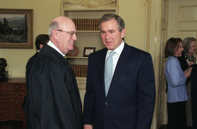 The Honorable George W. Bush (right), President of the United States, chats with the Honorable Laurence H. Silberman, United States Circuit Judge, United States Court of Appeals for the District of Columbia Circuit, after the Oath of Office Ceremony for the Honorable Donald H. Rumsfeld (not pictured), U.S. Secretary of Defense, at the Oval Office of the White House, Washington, D.C., Jan. 26, 2001. OSD Package No. 010126-D-9880W-001-012 (PHOTO by Robert D. Ward) (Released)