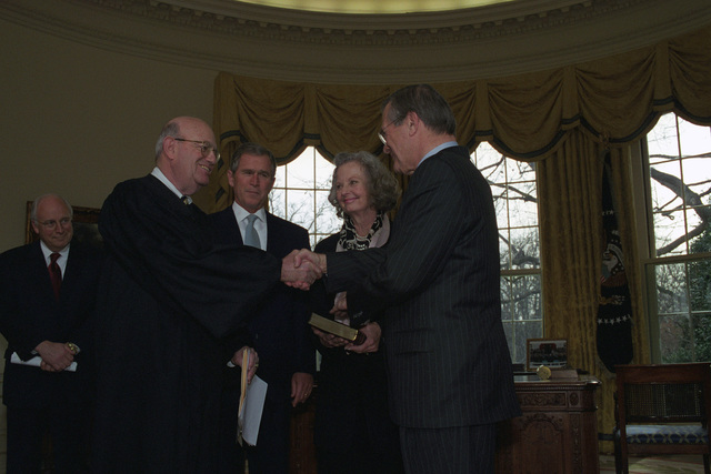 The Honorable Laurence H. Silberman (foreground, left), United States Circuit Judge, United States Court of Appeals for the District of Columbia Circuit, congratulates the Honorable Donald H. Rumsfeld (foreground, right), U.S. Secretary of Defense, during his Oath of Office Ceremony at the Oval Office of the White House, Washington, D.C., Jan. 26, 2001.  The Honorable George W. Bush (center, left), President of the United States, Mrs. Joyce Rumsfeld (center, right), and the Honorable Richard B. Cheney (left), Vice President of the United States, are also in attendance.  OSD Package No. 010126-D-9880W-001-012 (PHOTO by Robert D. Ward) (Released)