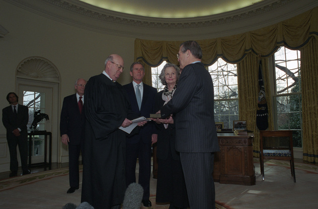 The Honorable Laurence H. Silberman (foreground, left), United States Circuit Judge, United States Court of Appeals for the District of Columbia Circuit, issues the Oath of Office to the Honorable Donald H. Rumsfeld (foreground, right), U.S. Secretary of Defense, at the Oval Office of the White House, Washington, D.C., Jan. 26, 2001.  The Honorable George W. Bush (center, left), President of the United States, Mrs. Joyce Rumsfeld (center, right), and the Honorable Richard B. Cheney (left), Vice President of the United States, are also in attendance.  OSD Package No. 010126-D-9880W-001-012 (PHOTO by Robert D. Ward) (Released)