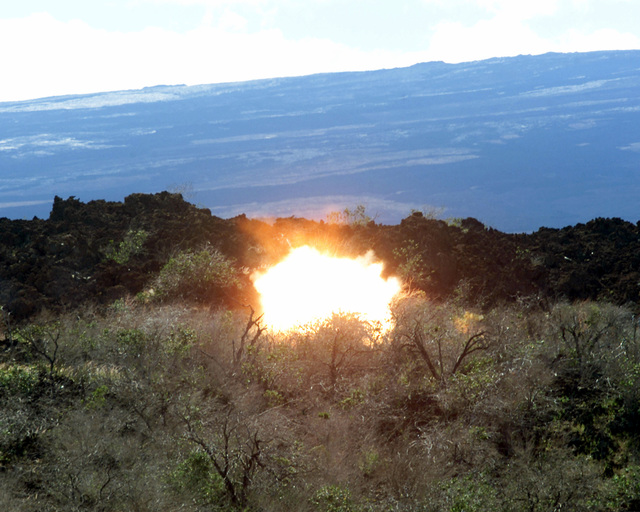A bright blast follows the impact of the explosive device at the head of an MK153 SMAW (Shoulder fired Missile Anti-tank Weapon) on Range 11D within the Pohakuloa Training Area (PTA), Hawaii. US Marine Corps Private First Class D. Bacon (not shown), of Charlie company 1ST Batallion 3rd Marine Regiment Assualt Section fired the SMAW during training for a Hawiian Combined Arms Operation or HCAO