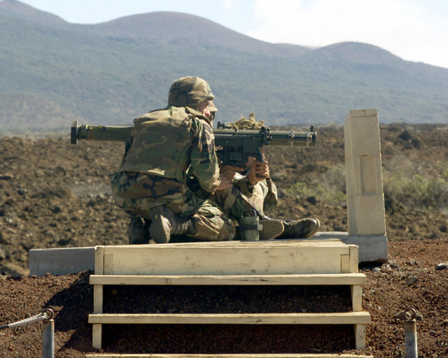 US Marine Corps Privates First Class N.R. Smith and Moore, both from Company C, 1ST batallion, 3rd Marine Regiment, prepare to launch a missile from a SMAW or shoulder fired missle anti-tank weapon. These Marines are practicing on one of the ranges in the Pohakuloa Training Area (PTA) on the island of Hawaii during a HCAO or Hawaiian Combined Arms Operation