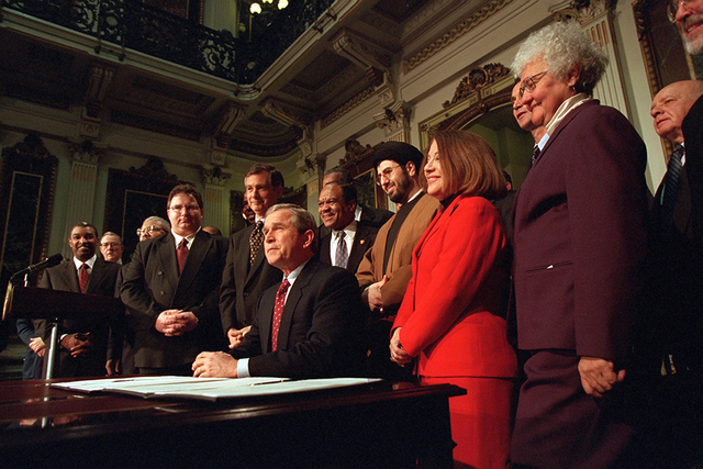 President George W. Bush signing of Executive Order 13198:  The Establishment of White House Office of Faith-Based and Community Initiatives