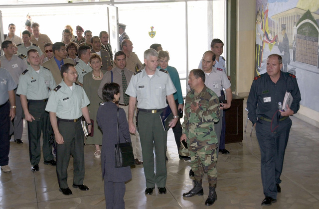 US Army Colonel (COL) Jeffery T. Christiansen, US Army South, Deputy Commander for Operations and Co-Director for Peacekeeping Operations South-01, center, and others are given a tour of the Ecuador Military Academy with Ecuadorian Army COL Fabian Narvaez, Assistant Co-Director for Peacekeeping Operations South-01, during the Mid-Planning Conference for United Forces Peacekeeping Operations South-01, Quito, Ecuador