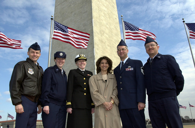 With the Washington Monument as a backdrop (from left to right) US Air Force MASTER Seregant Rick Bumgardner, US Air Force Reservist STAFF Sergeant Sarah Kavanaugh, US Navy Reservist Lieutenant Junior Grade Lola Britton, Penny Reed, US Air Force MASTER Sergeant Michael A. Reed and US Air Force Technical Sergeant Abdon Padilla II, of the Armed Forces Inaugural Committee (AFIC) get a group photo taken after MSGT Reed, deployed from the 367th Training Support Squadron, Hill Air Force Base, Utah, is officially reenlisted into the Air Force by US Navy Reservist Lieutenant Junior Grade Lola Britton, in Washington, D.C. The 2001 Armed Forces Inaugural Committee (AFIC) carries on a more than ...