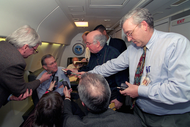 The Honorable Donald H. Rumsfeld (left, rear), U.S. Secretary of Defense (SECDEF), meets with the traveling press on his plane somewhere over the Atlantic Ocean en route to the 37th Annual Munich Conference on Security Policy, Munich, Germany, Feb. 2, 2001.  The press from left to right are:  James Garamone, Armed Forces Information Service, Ms. Andrea Stone, USA Today, Charlie Aldinger, Reuters, Robert Burns, Associated Press, and James Mannion, Agency France Presse.  OSD Package No. 010202-D-2987S-001 (PHOTO by Helene C. Stikkel) (Released)