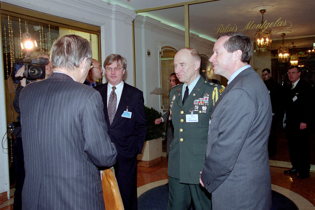 The Honorable Donald H. Rumsfeld (back to camera), U.S. Secretary of Defense (SECDEF), bids farewell to Terry Snell (left), Charge Affairs, U.S. Embassy, Berlin, U.S. Army COL. Eric Hammersen, Defense Attache'to the U.S. Embassy, Berlin, and Robert W. Boehme, Consuls and Consuls General, U.S. Consulate, Munich, at the 37th Munich Conference on Security Policy in Munich, Germany, Feb. 3, 2001.  OSD Package 010203-D-2987S-001-030 (PHOTO by Helene C. Stikkel) (Released)