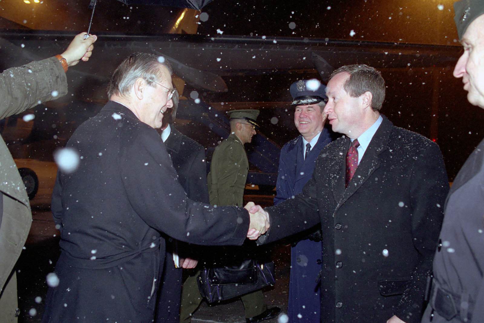 The Honorable Donald H. Rumsfeld (left), U.S. Secretary of Defense (SECDEF), arrives at Munich International Airport, Feb. 3, 2001, and is greeted by Terry Snell, Charge Affairs, U.S. Embassy, Berlin, U.S. Air Force GEN. Joseph Ralston, Consulate, Munich, and U.S. Army COL. Eric Hammersen, Defense Attache'to the U.S. Embassy, Berlin.  OSD Package 010203-D-2987S-001-030 (PHOTO by Helene C. Stikkel) (Released)