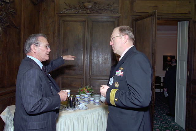 The Honorable Donald H. Rumsfeld (left), U.S. Secretary of Defense (SECDEF), speaks with U.S. Navy Rear Adm. Craig R. Quigley, Deputy Assistant Secretary of Defense for Public Affairs, at the 37th Munich Conference on Security Policy in Munich, Germany, Feb. 3, 2001.  OSD Package 010203-D-2987S-001-030 (PHOTO by Helene C. Stikkel) (Released)
