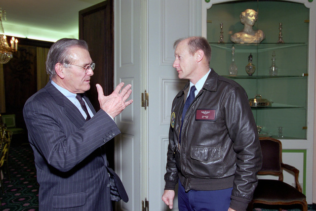 The Honorable Donald H. Rumsfeld (left), U.S. Secretary of Defense (SECDEF), speaks with U.S. Air Force COL. Jim Baxter, Flight Surgeon, at the 37th Munich Conference on Security Policy in Munich, Germany, Feb. 3, 2001.  OSD Package 010203-D-2987S-001-030 (PHOTO by Helene C. Stikkel) (Released)