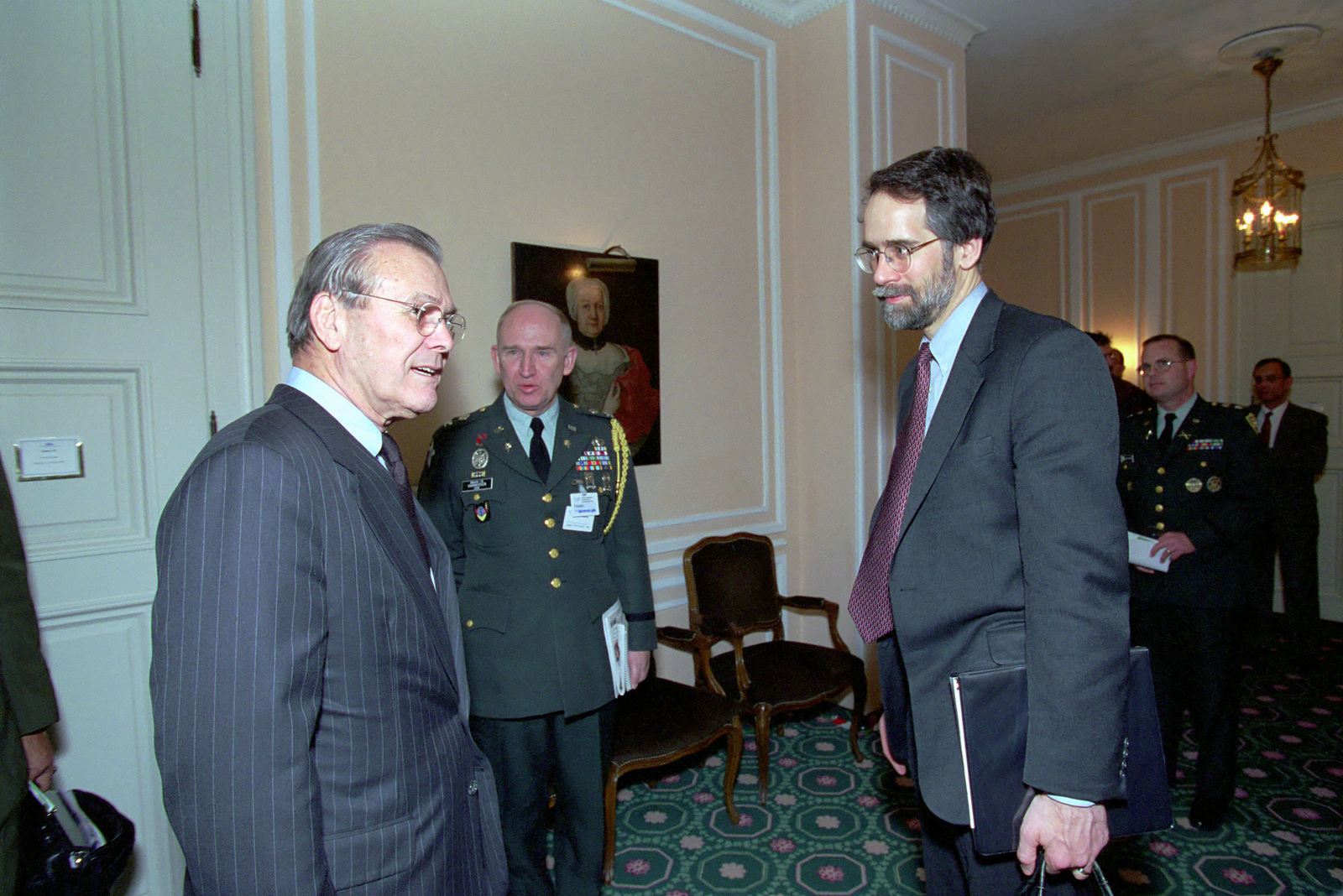 The Honorable Donald H. Rumsfeld (left), U.S. Secretary of Defense (SECDEF), speaks with Mr. Faabrycky, SENIOR Country Director, Germany, at the 37th Munich Conference on Security Policy in Munich, Germany, Feb. 3, 2001. U.S. Army COL. Eric Hammersen, Defense Attache'to the U.S. Embassy, Berlin, stands in the background. OSD Package 010203-D-2987S-001-030 (PHOTO by Helene C. Stikkel) (Released)