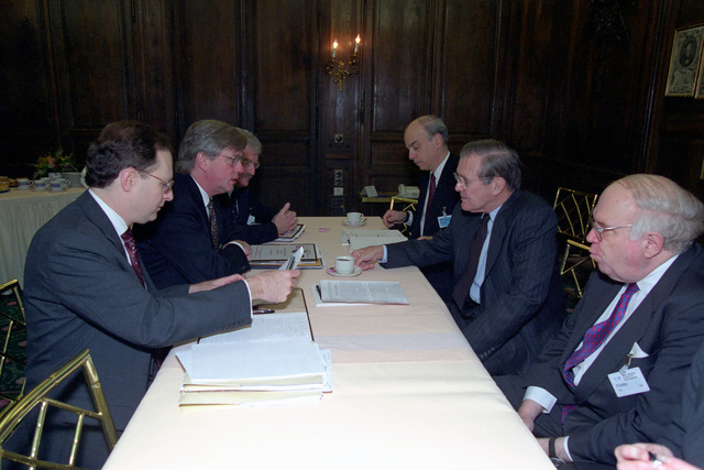 The Honorable Donald H. Rumsfeld (right, center), U.S. Secretary of Defense (SECDEF), meets with (clockwise from left) Alexander Vershbow, U.S. Ambassador to Russia, Terry Snell, Charge Affairs, U.S. Embassy, Berlin, Robert Hall, Franklin D. Kramer, Assistant SECDEF (International Security Affairs), and William Schneider, Jr., Assistant SECDEF, at the 37th Munich Conference on Security Policy in Munich, Germany, Feb. 3, 2001. OSD Package 010203-D-2987S-001-030 (PHOTO by Helene C. Stikkel) (Released)
