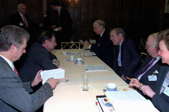 The Honorable Donald H. Rumsfeld (right, center), U.S. Secretary of Defense (SECDEF), meets with Dr. Javier Solana (left, center), Secretary General of the Council of the European Union/High Representative for the Common Foreign and Security Policy, at the 37th Munich Conference on Security Policy in Munich, Germany, Feb. 3, 2001. (DoD photo by Helene C. Stikkel) (Released)