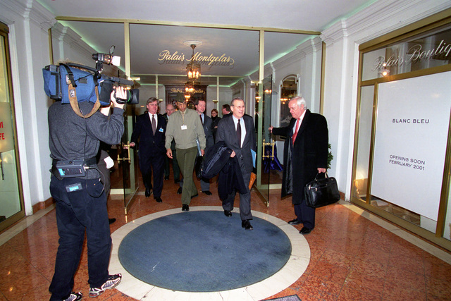 The Honorable Donald H. Rumsfeld (right), U.S. Secretary of Defense (SECDEF), is escorted out of the hotel at the 37th Munich Conference on Security Policy in Munich, Germany, Feb. 3, 2001.  OSD Package 010203-D-2987S-001-030 (PHOTO by Helene C. Stikkel) (Released)