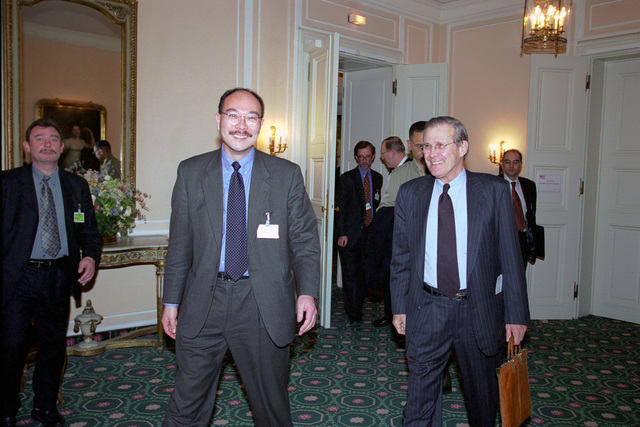 The Honorable Donald H. Rumsfeld (right), U.S. Secretary of Defense (SECDEF), is escorted out of the hotel by a U.S. Consulate staff member at the 37th Munich Conference on Security Policy in Munich, Germany, Feb. 3, 2001.  OSD Package 010203-D-2987S-001-030 (PHOTO by Helene C. Stikkel) (Released)