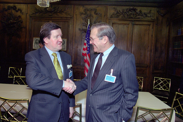 The Honorable Donald H. Rumsfeld (right), U.S. Secretary of Defense (SECDEF), shakes hands with Lord George Robertson, Secretary General, North Atlantic Treaty Organization (NATO), at the 37th Munich Conference on Security Policy in Munich, Germany, Feb. 3, 2001.  OSD Package 010203-D-2987S-001-030 (PHOTO by Helene C. Stikkel) (Released)