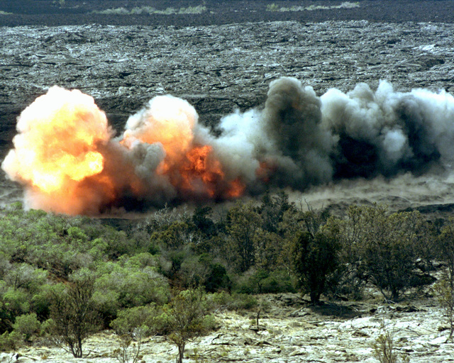 A rocket with a line of C-4 attached known as a line charge explodes within a mock mine field during a Hawaiian Combined Arms Operation in the Pohakuloa Training Area, Hawaii