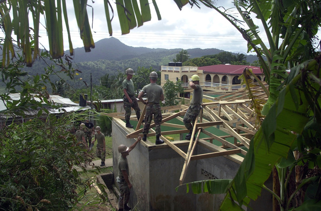 Members of the 8th Engineer Support Battalion, 2nd Fleet Service Support, Charlie Company, work to add roof supports on to the community center that they are remodeling for the people of Babonneau, Saint Lucia, in support of Operation NEW HORIZONS. Approximately 100 Marine, Army and Air Force personnel have deployed to Saint Lucia as part of New Horizons. The operation has a two fold mission of readiness training and humanitarian assistance in the Caribbean and Latin America