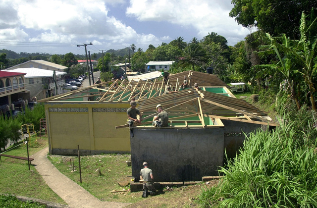 Members of the 8th Engineer Support Battalion, 2nd Fleet Service Support, Charlie Company, work to add the roof supports on to the community center that they are remodeling for the people of Babonneau, Saint Lucia, in support of Operation NEW HORIZONS. Approximately 100 Marine, Army and Air Force personnel have deployed to Saint Lucia as part of New Horizons. The operation has a two fold mission of readiness training and humanitarian assistance in the Caribbean and Latin America