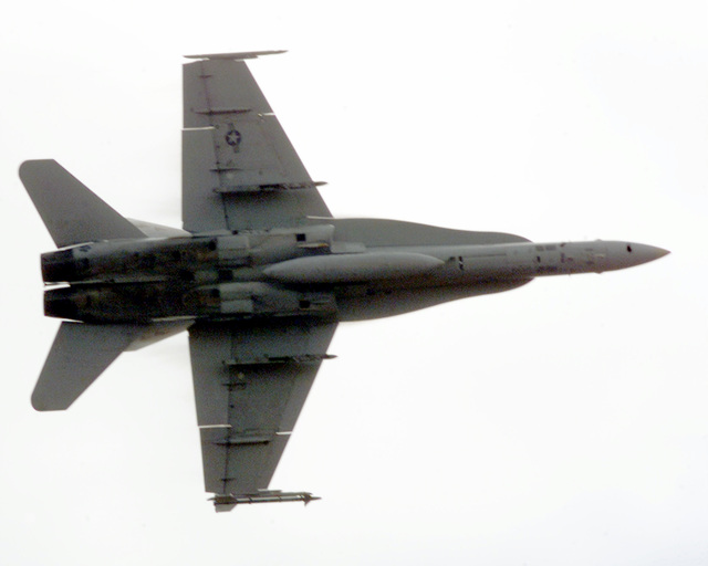An F-18 Hornet aircraft out of the Dallas/ Ft Worth area being piloted by a Marine reservist. The pilot is practicing manuevers during a Hawaiian Combined Arms Operation above the Pohakuloa Training Area, Hawaii