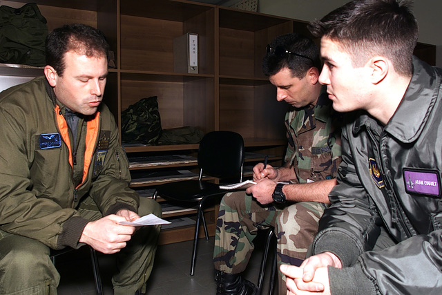 (from left to right) Italian Air Force Captain Vittorio Carminato, 83rd Combat Search and Rescue Squadron, briefs US Air Force STAFF Sergeant Rick Sapone and US Air Force Second Lieutenant Adam Cuquet from the 31st Fighter Wing, Aviano Air Base, Italy, prior to the start of a joint NATO search and rescue exercise in Rimini, Italy. The joint mission allows the two countries to put into practice procedures that will maintain search and rescue proficiency