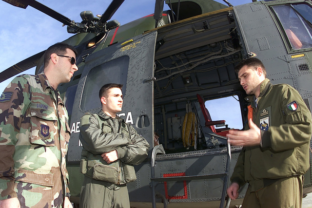 Italian Air Force Lieutenant Dario de Liguorno, 83rd Combat Search and Rescue Squadron, gives last minute instructions to US Air Force STAFF Sergeant Rick Sapone and US Air Force Second Lieutenant Adam Cuquet, 31st Fighter Wing, Aviano Air Base, prior to a joint NATO search and rescue exercise in Rimini, Italy. The joint mission allows the two countries to put into practice procedures that will maintain search and rescue proficiency