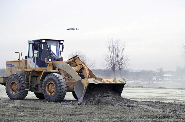 Members of the 51st Civil Engineering Squadron, Osan Air Base, use a Samsung front-loader to fill bomb craters on a simulated flight line, during the RESTORATION OF OPERATION (RESTOPS) Exercise