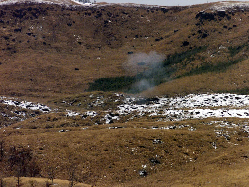 Rounds from the M198 155mm Towed Howitzer impact the mountainous terrain, seaparating soil from snow during Third Division/12th Marine Regiment (3/12) Charlie Battery's artillery relocation excercise. Charlie Battery is deployed in support of the unit's artillery relocation excercise, and cold weather training, at Camp Hijudai, Oita, Japan