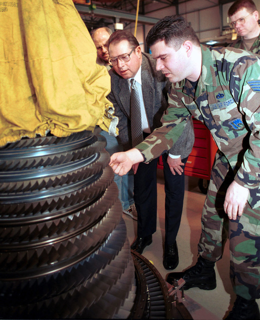 STAFF Sergeant David Harman, from the 48th Component Repair Squadron's Propulsion Shop, briefs Mr. Otha Davenport, Director of Engineering, Propulsion Product Group Aeronautical Systems Center, on a jet engine, during a visit to Royal Air Force Lakenheath