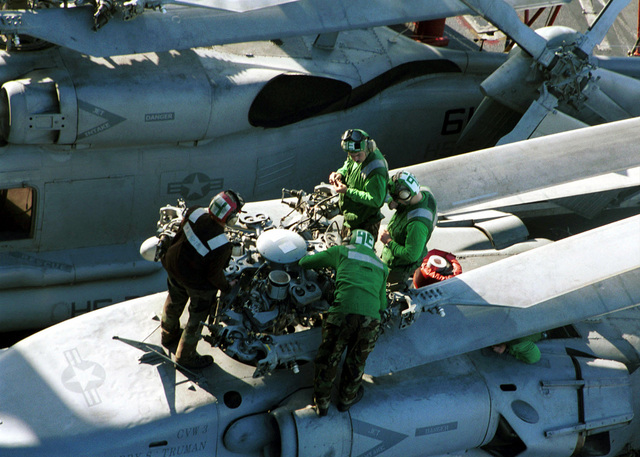 Sailors work together to perform maintenance to the rotors of a SH-53F helicopter from Helicopter Antisubmarine Squadron Seven (HS-7) prior to flight operations on board USS HARRY S. TRUMAN (CVN 75). Truman is on station in the Persian Gulf in support of Operation SOUTHERN WATCH