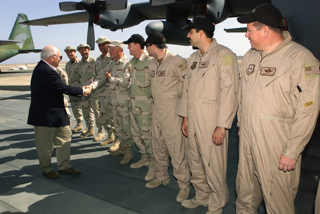 US Vice President Richard Cheney greets the crewmembers of an Air National Guard C-130 Hercules aircraft, from his home state of Wyoming. Vice President Cheney meet with deployed US Military personnel, at an undisclosed location during Operation ENDURING FREEDOM
