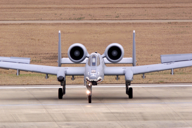 An A-10A Warthog aircraft from the 23rd Wing, Pope Air Force Base, North Carolina, stops on the taxiway to give a head-on profile to the crowd watching (not shown) at the Operation DESERT STORM 10th Anniversary Air Tattoo held at Shaw Air Force Base, South Carolina